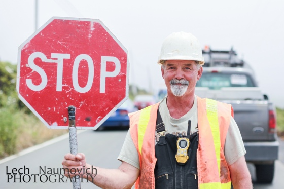 Bill the construction worker, happy to be operating the sign for a break from the heavy equipment.